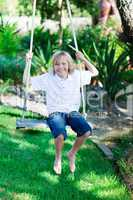 Kid having fun on a swing
