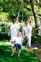 Father, mother and son swinging
