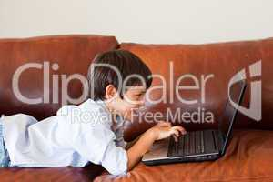 Kid using his laptop