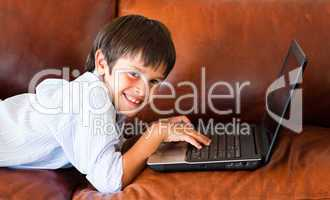 Child playing with his laptop