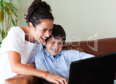 Mother and son having fun with a laptop