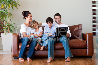 Family playing together with a laptop