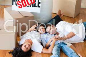 Family moving house sleeping on floor