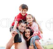 Parents giving children piggyback rides