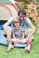 Father and son playing in a tent