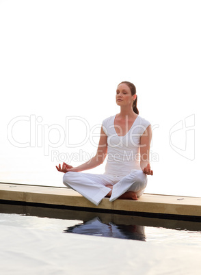 Woman meditating near the sea