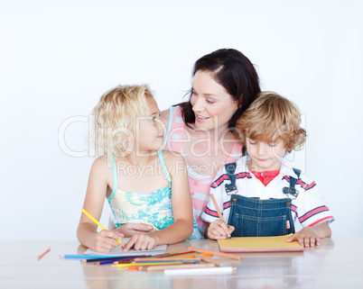 Mother and children doing homework together