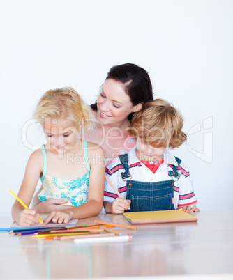 Mother painting with her children