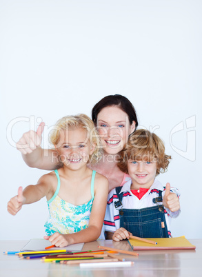 Children doing homework with their mother with copy-space