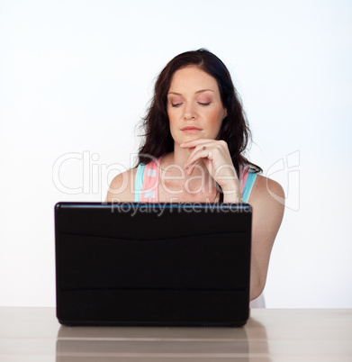 Serious woman working with her laptop