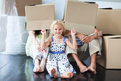 Family having fun in its new house