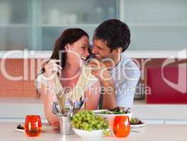 Lovers eating in the kitchen