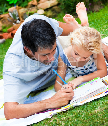 Dad and daughter painting in a garden
