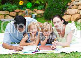 Happy family painting in a garden