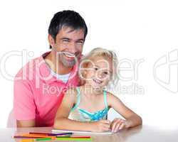Daughter and father drawing looking at the camera