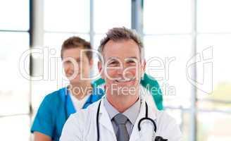 Senior doctor leading his team
