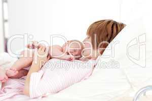 Woman kissing her newborn baby
