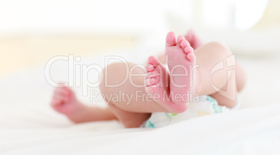 Newborn baby lying in bed