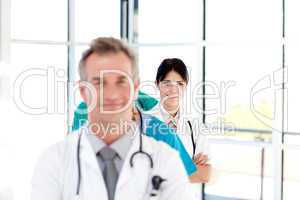 Confident young female doctor smiling at the camera