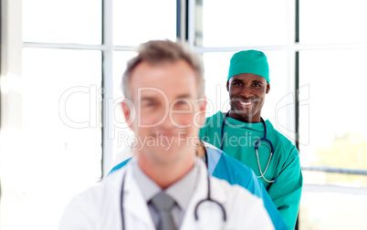 Smiling surgeon in a row