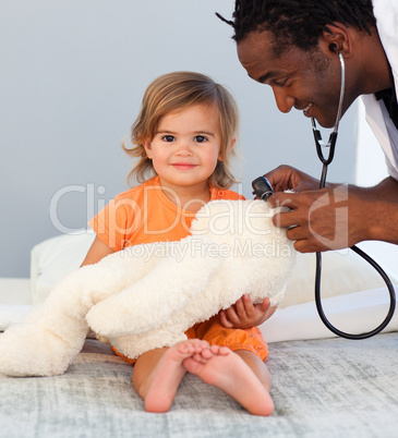 Children's doctor exams a little girl with stethoscope