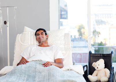 Hispanic patient resting in bed
