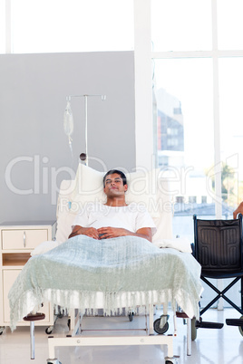 Young patient recovering in bed with copyspace