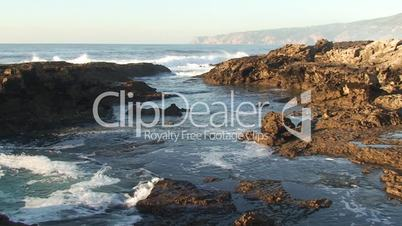 Sea waves against rock in the beach