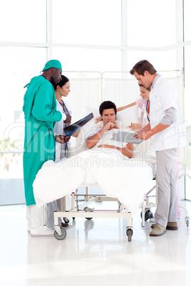 Doctors speaking to a patient