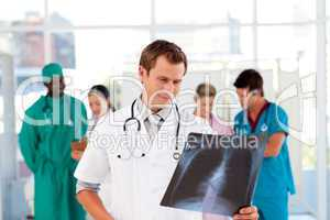 Doctor examinig an X-ray with is team