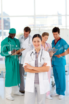 Smiling female doctor with her team