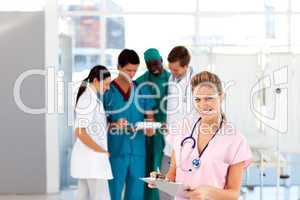 Beautiful nurse with her team in the background