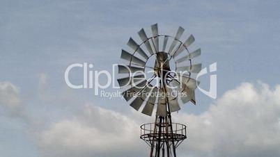 Farm windmill against sky