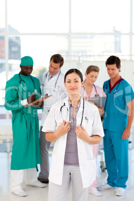 Female doctor with her team in the background
