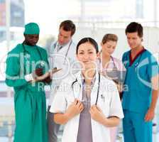 Beautiful doctor with her team in the background