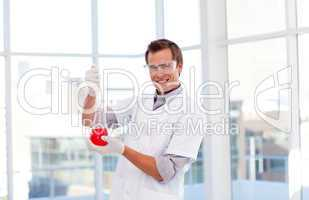 Young scientist examinig a test-tube