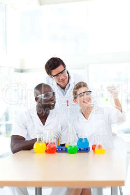 Science students examining a test-tube