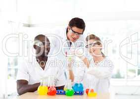 Group of scientists examining test-tubes