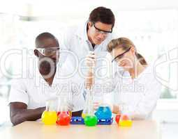 Young scientists examining test-tubes