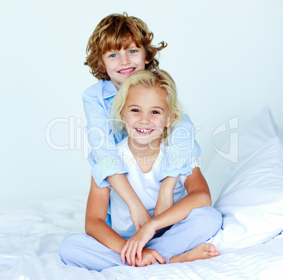 Brother hugging his sister good night
