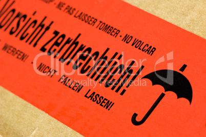 Paket Mit Aufkleber Vorsicht Zerbrechlich Lizenzfreie