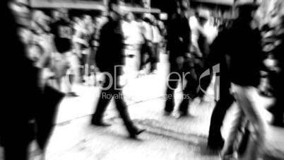b/w blured scene of people