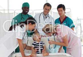 Doctors taking care of a young child