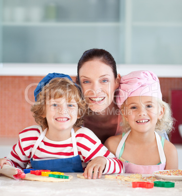Mother with her Two Kids looking at the camera smiling