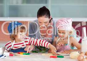 Mother Interacting with Children in Kitchen