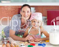 Mother and childing in Kitchen Smiling at Camera