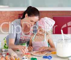 Potrait of money and Daugether in Kitchen Baking