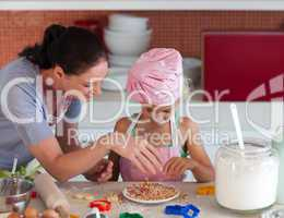 Mother teaching Child how to cook