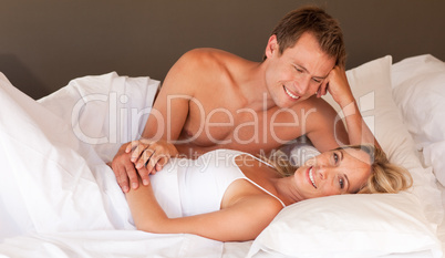Romantic young couple lying on a bed