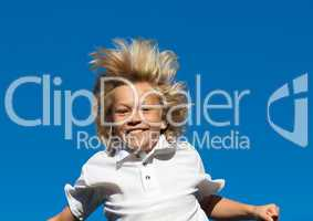 Boy Jumping on a trampoline